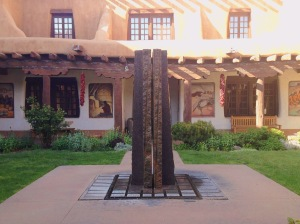 Museum courtyard lined with artwork by WIll Shuster